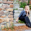 Girl on the stone steps - Stock Photo