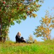Woman under mountain ash tree - Stock fotografie