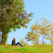 Woman under mountain ash tree — Stock Photo
