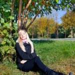 Woman under mountain ash tree — Stock Photo