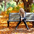 Girl on a bench in park — Stock Photo #7479644