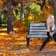 Girl on a bench in park — Stock Photo #7479660