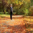 Girl in autumn park — Stock Photo #7479710