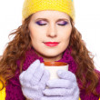 Beautiful girl wearing winter clothes with cup — Stock Photo