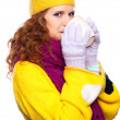 Stock Photo: Beautiful girl wearing winter clothes with cup
