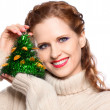 Portrait of a beautiful girl with a Christmas toy — Stock Photo