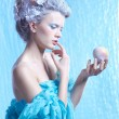 Frozen fairy with apple — Stock Photo