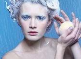 Frozen fairy with apple — Stock Photo