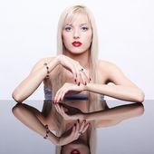 Beautiful blonde in jewelry — Stock Photo