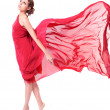 Beautiful woman in red flying dress — Stock Photo #7957035