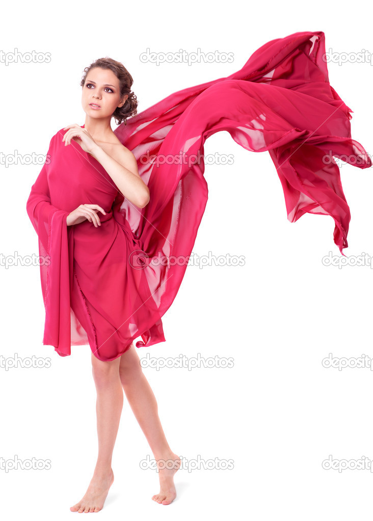 Beautiful woman in red flying dress isolated on white background — Stock Photo #7956965