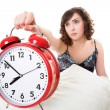 Woman with alarm clock - Stock Photo