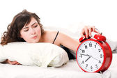 Woman with alarm clock — Stock Photo