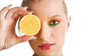 Woman holding lemon — Stock Photo