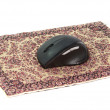 Stock Photo: Computer mouse on a mat