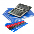 Exercise book with pen and calculator — Stock Photo