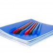 Exercise book with pens — Stock Photo #7418252
