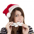 Stock Photo: Girl in a Santa Claus hat