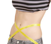Young girl measuring her waist — Stock Photo