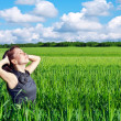 Young woman in the wheat field — Stock Photo #6775206