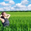 Young woman in the wheat field — Stock Photo