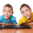 Twins with computer mouse and keyboard — Stock Photo