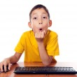 Boy sitting in front of computer — Stock Photo #7329685