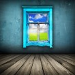 Blue room with wooden floor and window with field and sky above — Stock Photo