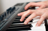 Male hands playing the piano — Stock Photo
