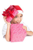 Boy in christmas red hat holding a gift box — Stockfoto