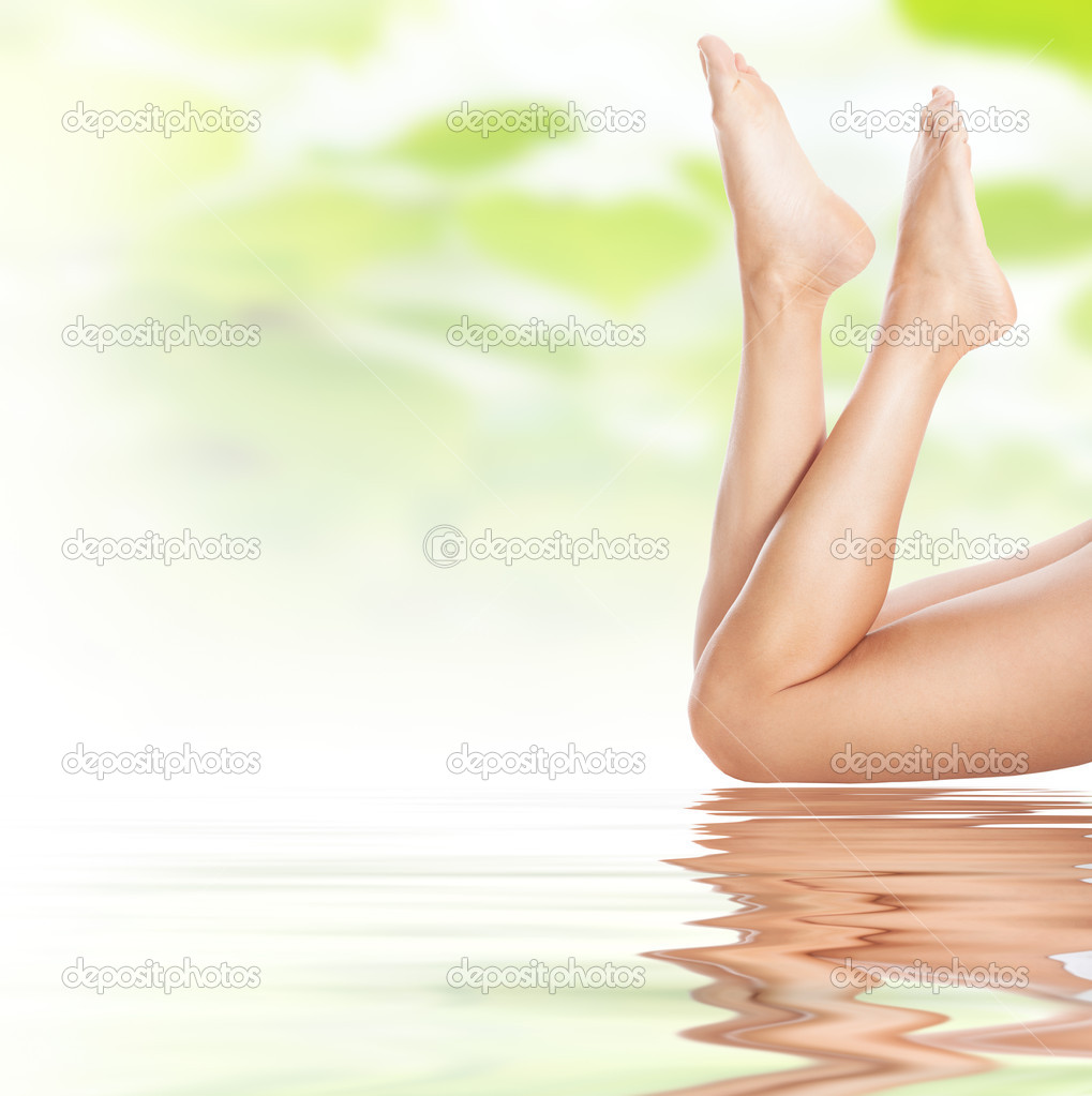 Healthy sexy slender female legs on water - spa and healthcare concept  Stock Photo #7624923