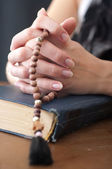 Emale hands with rosary — Stock Photo