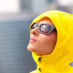 Girl in a yellow hood — Stock Photo