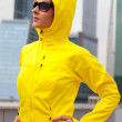 Girl in a yellow hood — Stock Photo