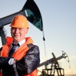 Engineer in an Oil field - Stock Photo