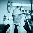 Worker in an Oil field - Stock Photo