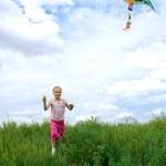 Child run on field — Stock Photo