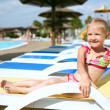 Stock Photo: Child in blue water of the swimming pool