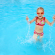 Child in blue water of the swimming pool — Stock Photo