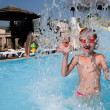 Child in blue water of the swimming pool — Stock Photo #6874144