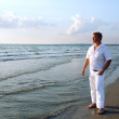 Man in white clothing at sea - Stock Photo