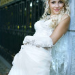 Beauty bride in white dress — Stock Photo