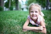 Girl on the grass — Stock fotografie