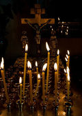 Cross and candles — Stock Photo