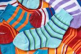 Many pairs of child's striped socks — Stock Photo