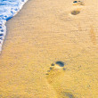 Footprint on sand with foam — Stock Photo #7678583