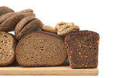 Bread on wood board. — Stock Photo