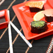Stock Photo: Red plate of sushi