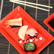 Sushi in red plate — Stock Photo