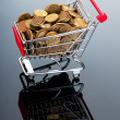 Shopping cart and gold coins — Stock Photo #6818313